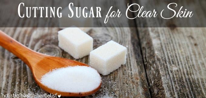 cutting sugar for clear skin - a soop with spilled sugar and sugar cubes